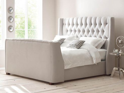 Orwell Buttoned Sleigh Bed